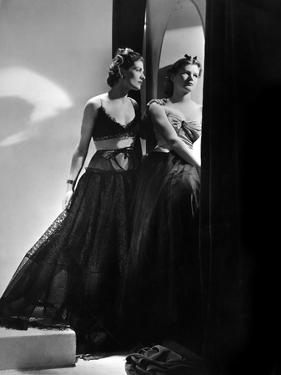 Models Wearing (From Left) Black Lace Gown with Lace Brassiere Top