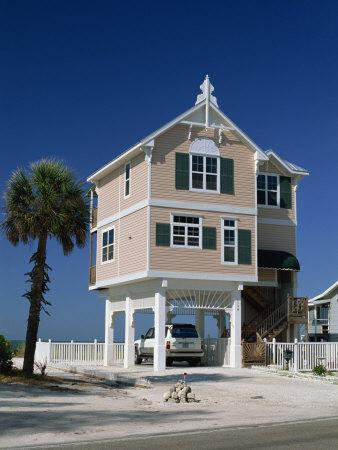 https://imgc.allpostersimages.com/img/posters/modern-house-by-the-beach-in-the-gulf-coast-town-of-bradenton-beach-south-of-tampa-florida-usa_u-L-P7NV1C0.jpg?artPerspective=n