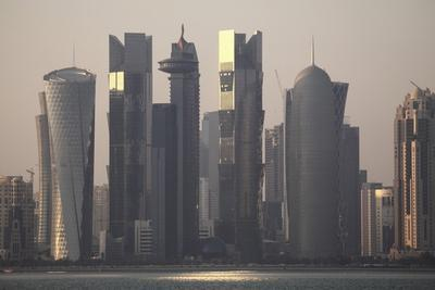 https://imgc.allpostersimages.com/img/posters/modern-skyscrapers-in-the-west-bay-financial-district-of-doha-qatar-middle-east_u-L-PQ8O3N0.jpg?artPerspective=n