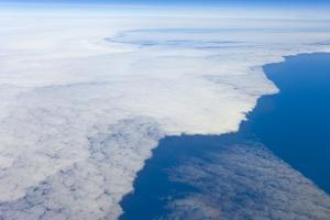 Aerial View of Clouds above Pacific Ocean near Chile by Momatiuk - Eastcott