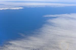 Aerial View of Clouds and Ocean near Chile by Momatiuk - Eastcott
