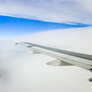Airplane Wing above Clouds by Momatiuk - Eastcott