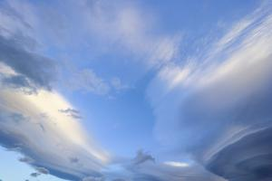 Bright Cumulus and Lenticular Clouds at Sunrise by Momatiuk - Eastcott