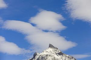 Clouds above Mountain Peak by Momatiuk - Eastcott