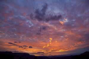 Colored Clouds above Colorado River at Sunset by Momatiuk - Eastcott