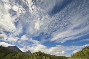 Cumulus and Cirrus Clouds above Mountains by Momatiuk - Eastcott
