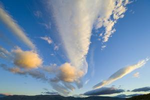 Cumulus Clouds above Mountains at Sunset by Momatiuk - Eastcott