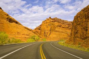Highway among Steep Red Sandstone Buttes by Momatiuk - Eastcott