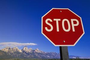 Stop Sign near Teton Range, Wyoming by Momatiuk - Eastcott