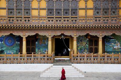 https://imgc.allpostersimages.com/img/posters/monk-walking-through-punakha-dzong-punakha-district-bhutan-asia_u-L-Q12SD3Q0.jpg?p=0