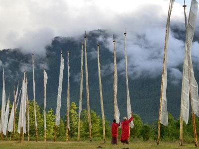 https://imgc.allpostersimages.com/img/posters/monks-with-praying-flags-phobjikha-valley-gangtey-village-bhutan_u-L-P58CIS0.jpg?p=0