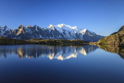 https://imgc.allpostersimages.com/img/posters/mont-blanc-top-of-europe-reflected-during-sunrise-in-lac-es-cheserys_u-L-PWFMHI0.jpg?p=0