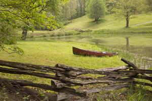Canoe & Fence by Monte Nagler