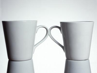 Two Cups with Handles Touching
