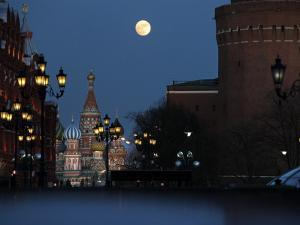 Moon is Seen over the Red Square in Moscow with the St. Basil Cathedral in the Background