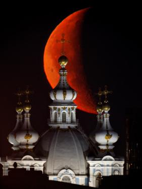 Moon is Seen Rising in the Sky Above the Domes of the Smolny Cathedral in St.Petersburg, Russia