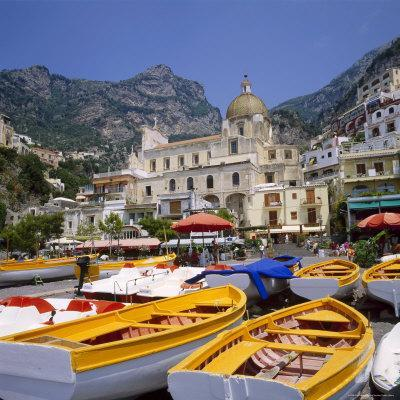 https://imgc.allpostersimages.com/img/posters/moored-boats-and-church-positano-campania-itay_u-L-P2QVTP0.jpg?artPerspective=n
