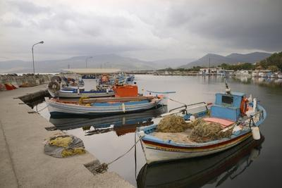 https://imgc.allpostersimages.com/img/posters/moored-fishing-boats-in-apothika-village-harbour-greece_u-L-Q12SBVS0.jpg?p=0