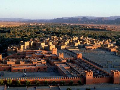 https://imgc.allpostersimages.com/img/posters/morocco-general-view-overlooking-tinerhir-at-sunset-1970s_u-L-P5F6PL0.jpg?p=0