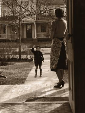Mother on Porch Seeing Son Off To School, Rear View
