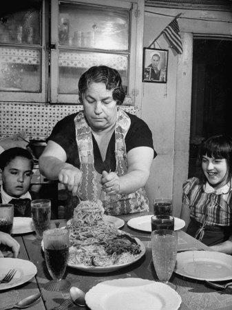 https://imgc.allpostersimages.com/img/posters/mother-serving-spaghetti-to-her-children_u-L-P732XH0.jpg?artPerspective=n