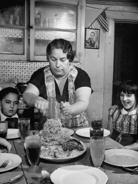 Mother Serving Spaghetti to Her Children