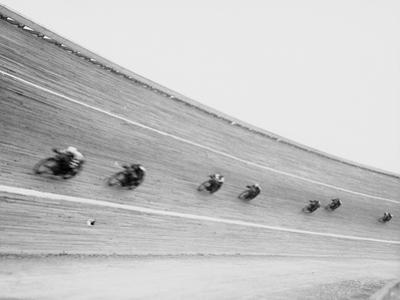 Motorcycles Racing on Sloped Track