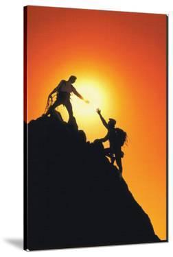 Mountain Climbers Reaching Summit