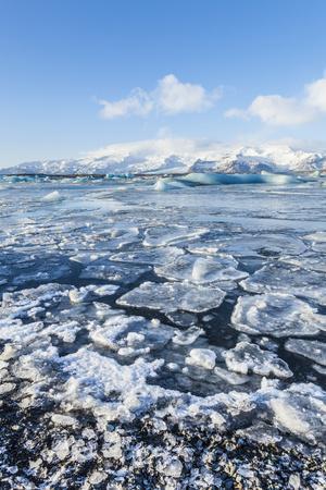 https://imgc.allpostersimages.com/img/posters/mountains-behind-the-frozen-water-of-jokulsarlon-iceberg-lagoon-jokulsarlon-south-east-iceland_u-L-PWFKJR0.jpg?p=0