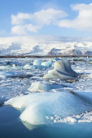 https://imgc.allpostersimages.com/img/posters/mountains-behind-the-icebergs-locked-in-the-frozen-water-of-jokulsarlon-iceberg-lagoon_u-L-PWFJUR0.jpg?p=0