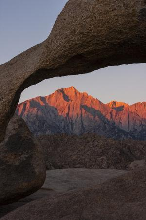https://imgc.allpostersimages.com/img/posters/mountains-seen-through-mobius-arch-alabama-hills-california-usa_u-L-PN71GO0.jpg?artPerspective=n