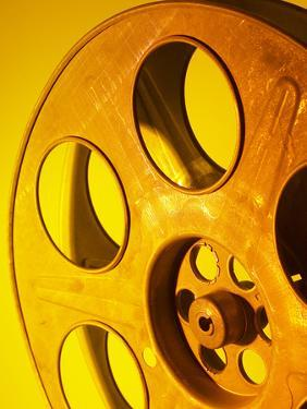 Movie Film and Reels in Yellow Light