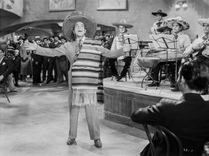 Al Jolson singing with a Band wearing a Mexican Hat by Movie Star News