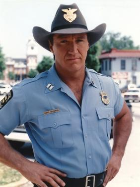 Alan Autry Posed in Police Outfit by Movie Star News
