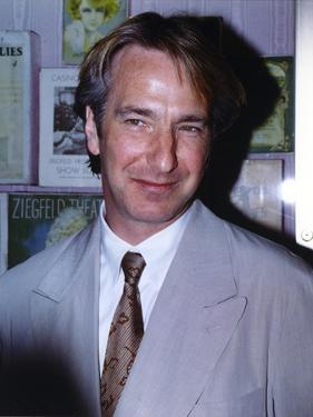 Alan Rickman smiling and wearing a Grey Suit Close Up Portrait by Movie Star News
