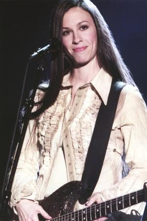 Alanis Morissette Playing Guitar in Coat by Movie Star News