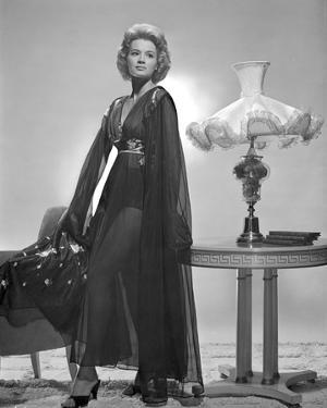 Angie Dickinson standing wearing Dress Black and White by Movie Star News