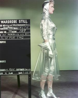 Anne Francis standing Facing Side View in Silver Glossy Dress by Movie Star News
