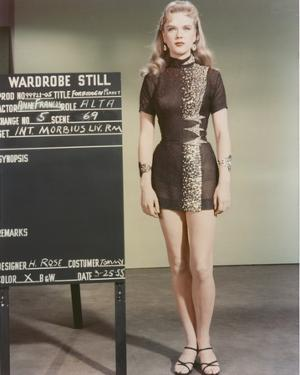 Anne Francis standing in Sexy Black Dress by Movie Star News