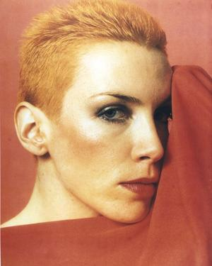 Annie Lennox posed in Close Up in Red Background by Movie Star News