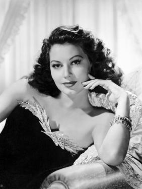 Ava Gardner posed on Couch in Black Dress with Necklace by Movie Star News