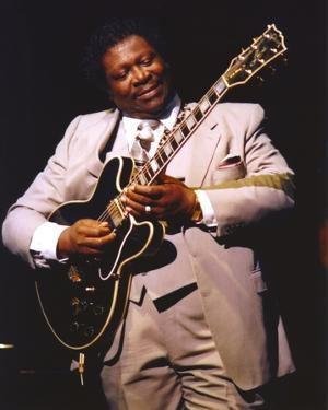 BB King Performing on Stage using Black Les Paul in Grey Suit with White Cuffs and Collar Shirt by Movie Star News