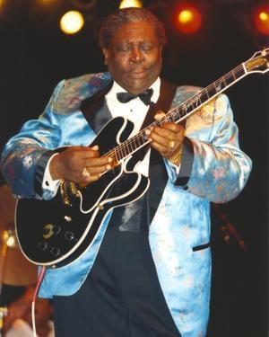 BB King Performing on Stage using Black Les Paul in Silk Blue Tuxedo with Black Cuffs by Movie Star News