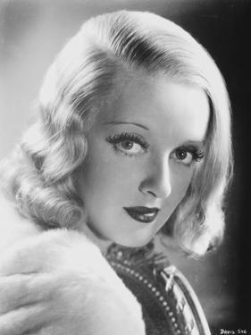 Bette Davis Portrait in White Fur Coat and Black Underclothes in Finger Curl Hairstyle by Movie Star News
