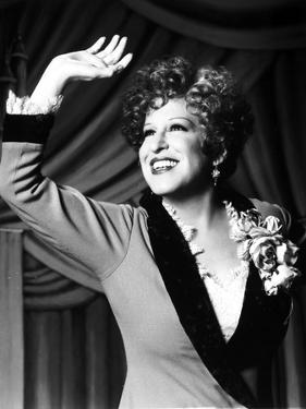 Bette Midler Portrait Waving Her Hand in Grey Linen Deep V-Neck Dress by Movie Star News