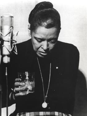 Billie Holiday Looking Down in Black Dress with Glass by Movie Star News
