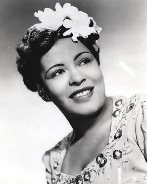 Billie Holiday smiling Close Up Portrait with Floral Accessories by Movie Star News