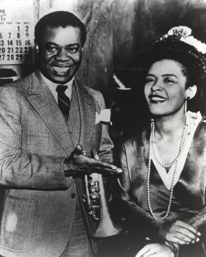 Billie Holiday smiling in Formal Suit Along with Woman by Movie Star News