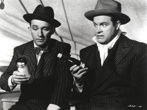Bob Hope Seated with Man, wearing Tuxedo with Hat Portrait by Movie Star News