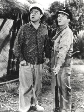 Bob Hope standing and Looking Up with Man in Police Uniform by Movie Star News